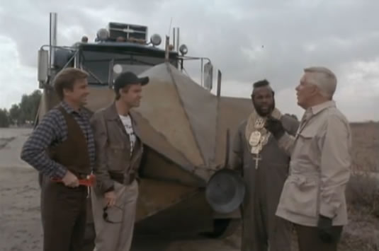 The team admires its new armor-plated semi-truck