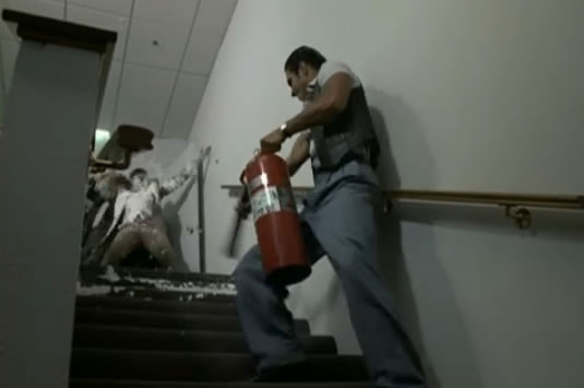 Frankie sprays the fire extinguisher