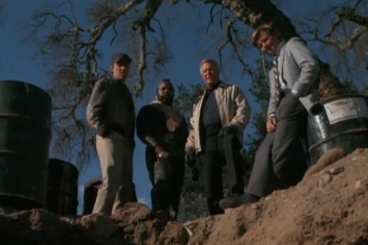 The A-Team looking at a hole in the ground