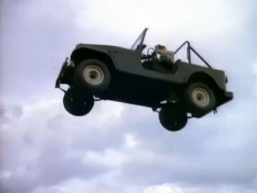 Woody Harrelson's Jeep flies... and explodes