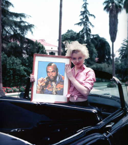 Marilyn Monroe holds a picture of Mr. T
