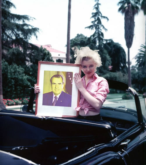 Marilyn Monroe holds a picture of Richard Nixon