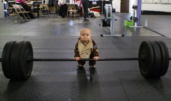 Toddler lifting weights