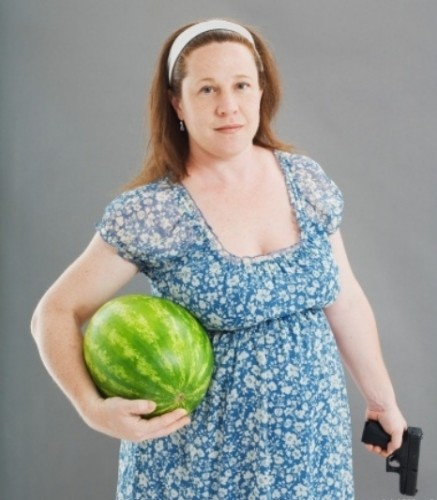 Woman with watermelon and gun