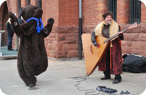 Guy in a bear suit and guy with a balalaika
