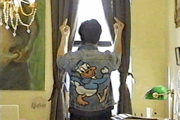 Dude in a Donald Duck jacket offers the double deuce