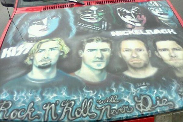 "KISS and Nickelback on the same car hood. ""Rock and roll will never die."""