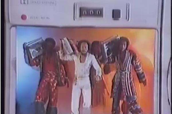 Three disco guys carrying boomboxes.