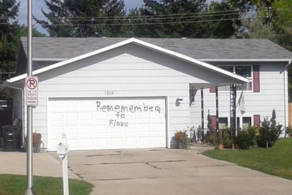 "Spray painted on a garage door: ""Remember to floss"""