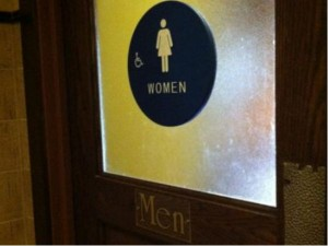 "Men's room sign also features a sign that says ""women"""