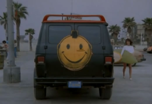 The van has a smiley face on its back doors!