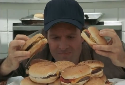 Murdock makes a stack of burgers
