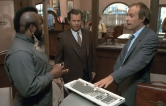 B.A. and Murdock try their computer scam at the bank