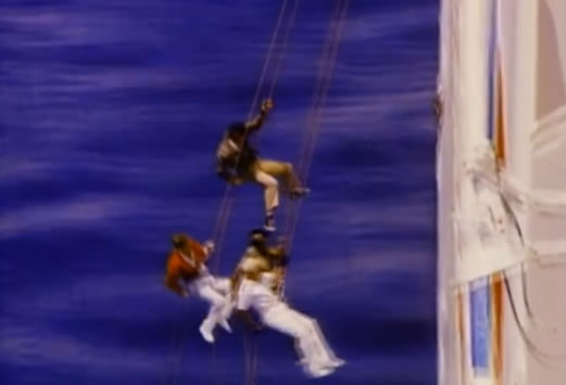 The team rappels off the side of the ship