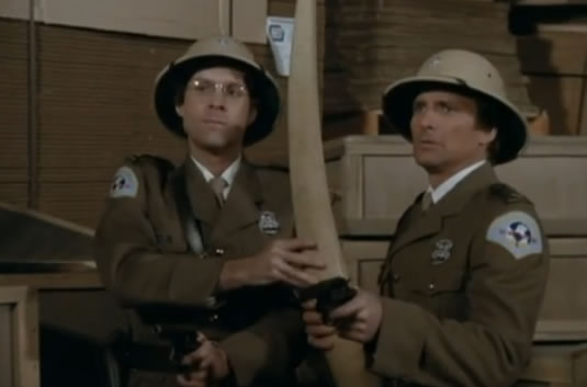 Face and Murdock in pith helmets