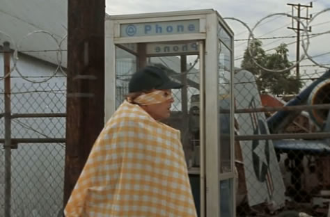 Captain Cab emerges from the phone booth