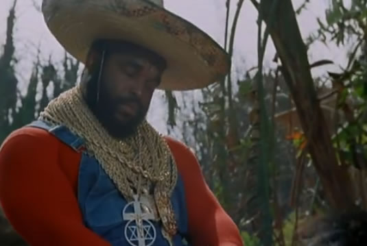 Unconscious B.A. rides a donkey and wears a sombrero