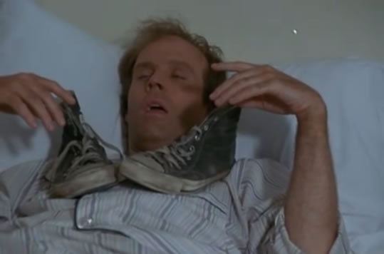 Murdock sleeps with his shoes nearby