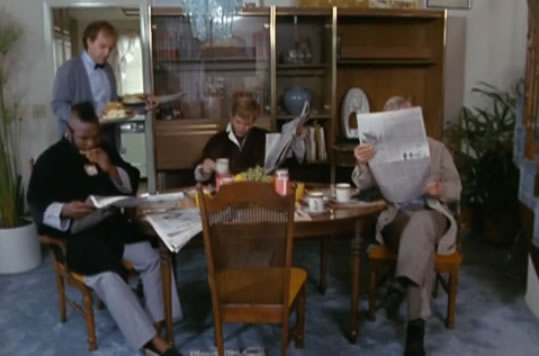 Murdock serves breakfast while B.A., Face and Hannibal read newspapers