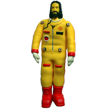 yellow Jesus action figure in astronaut suit