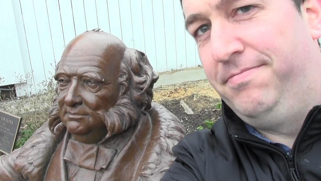 Brady with a statue of Martin Van Buren