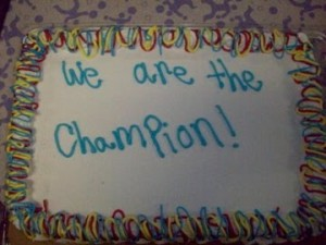 Cake says 'We are the champion'
