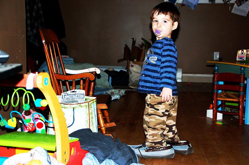 Owen wears Mama's slippers