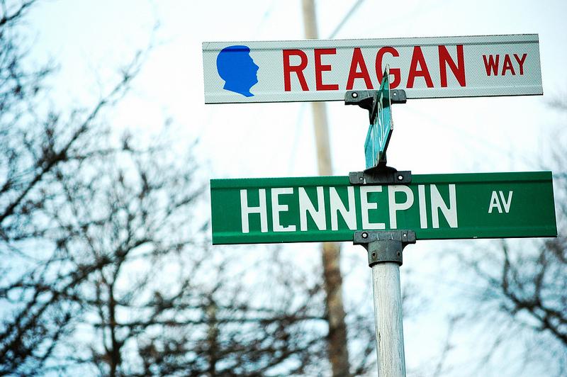 Reagan Way sign above Hennepin Av street sign