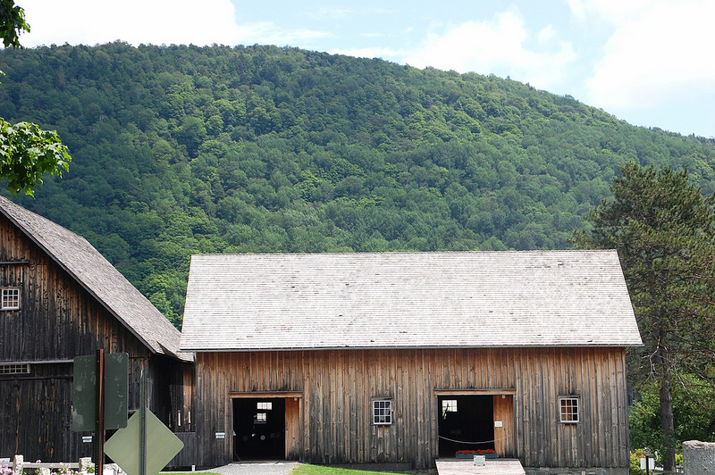 Barn at Calvin Coolidge State Historic Site, Plymouth Notch, Vermont, with a tree-covered mountain as the backdrop.