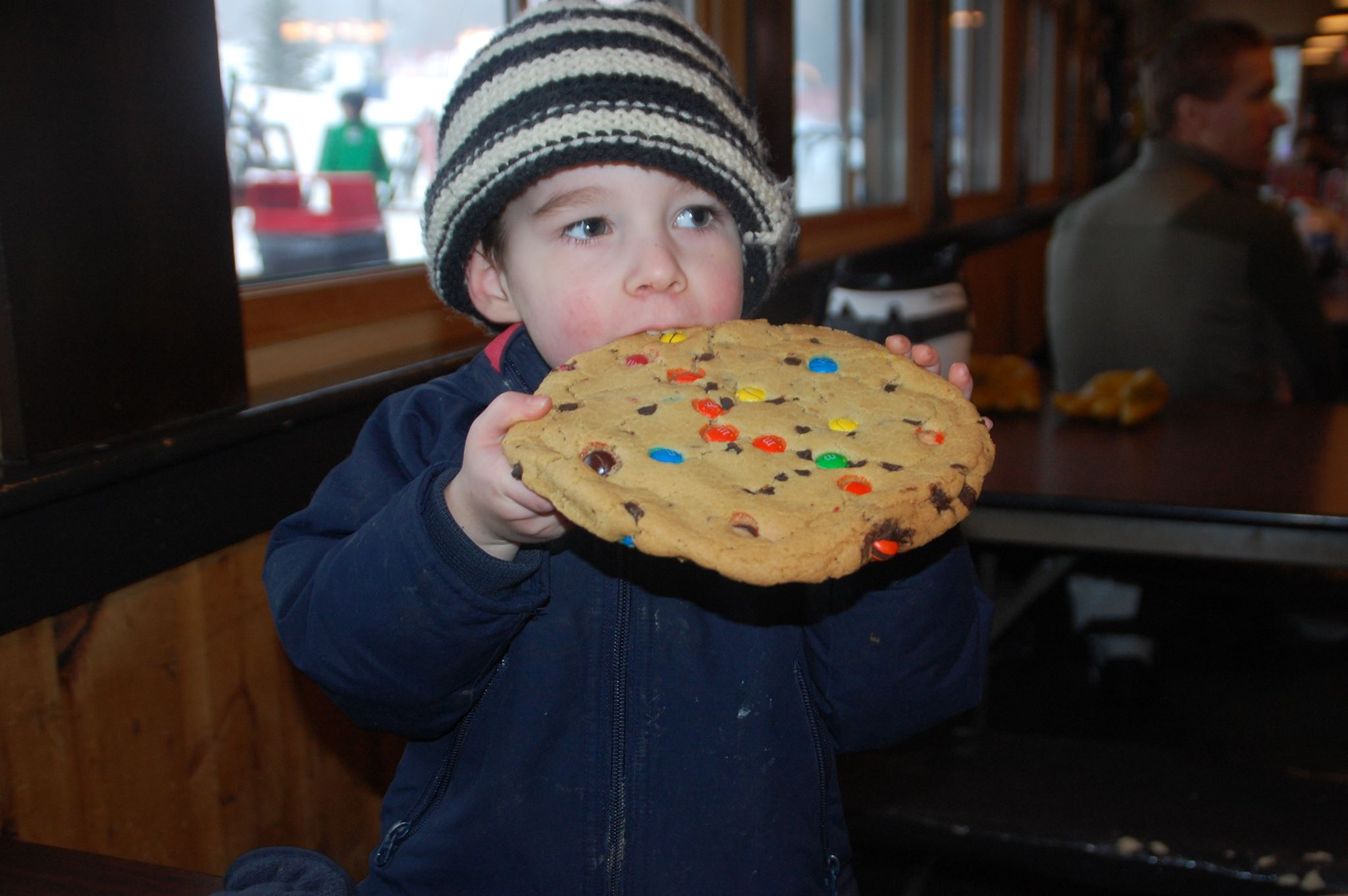 Three year old eats an M&M cookie that's bigger than his head