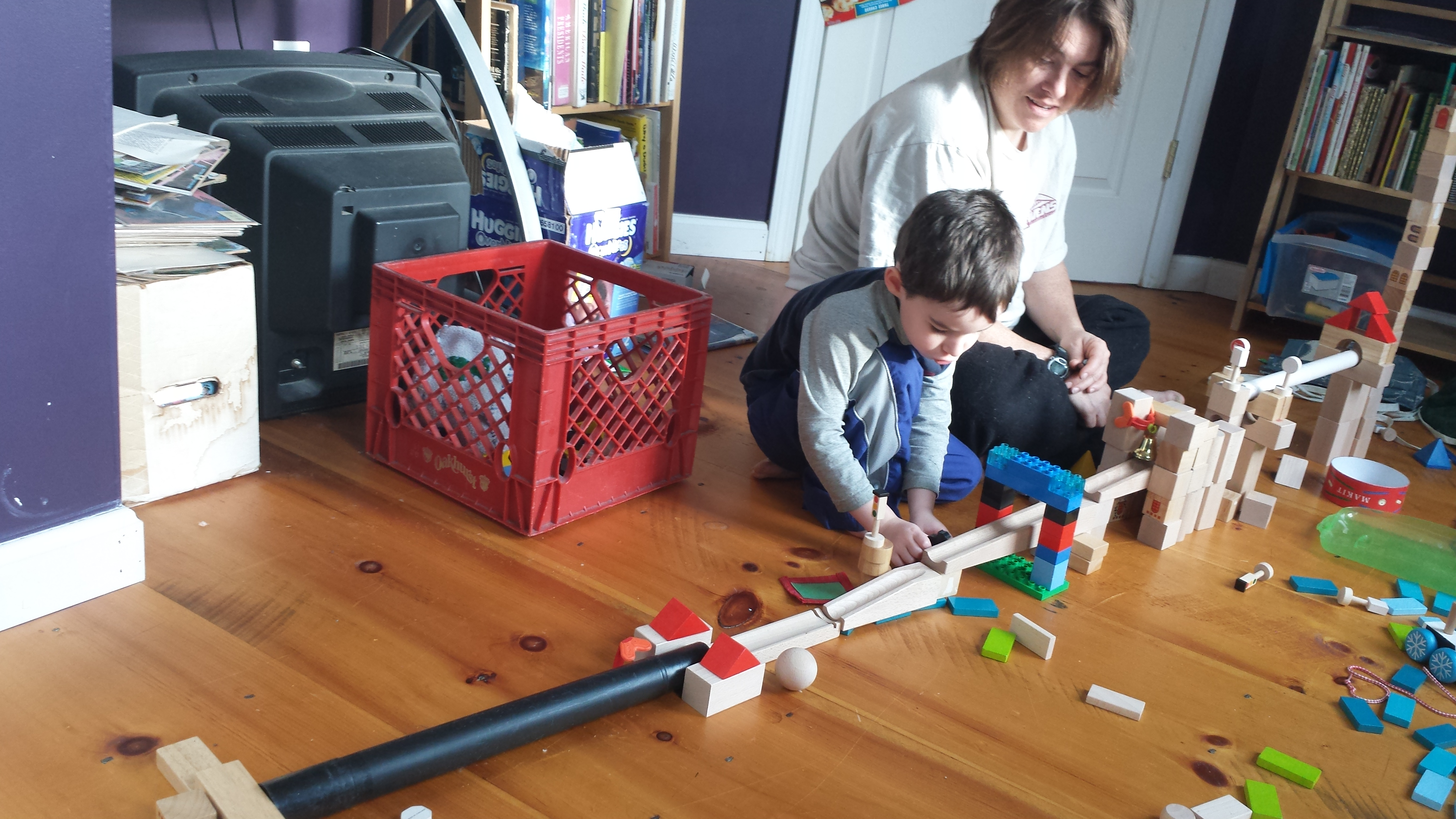 Owen and Sonya make a marble track.