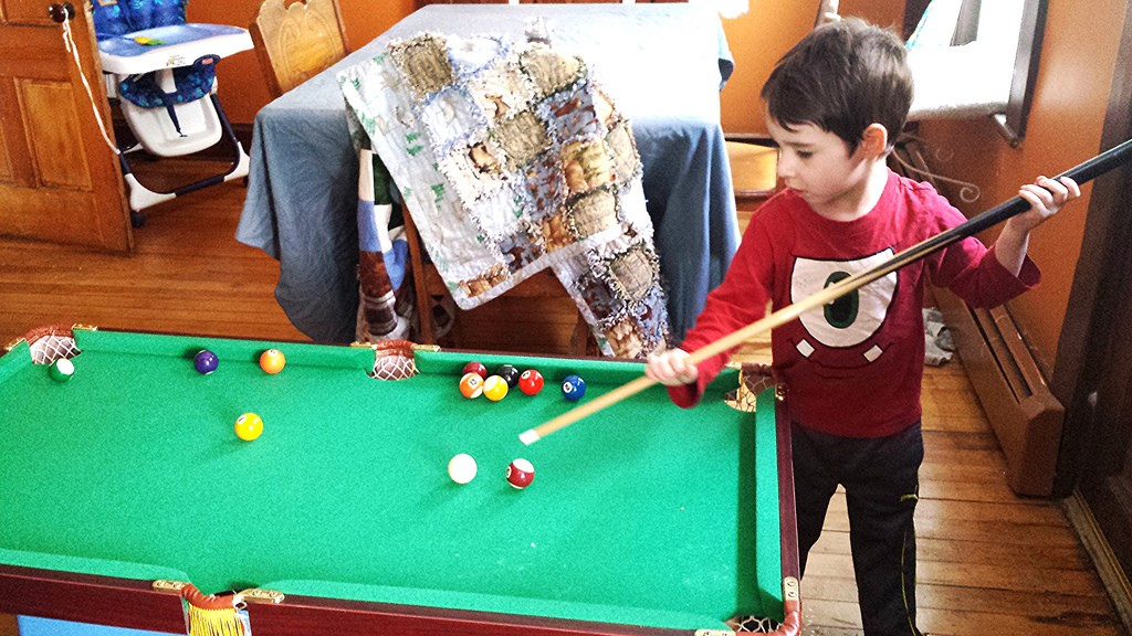 Owen playing billiards