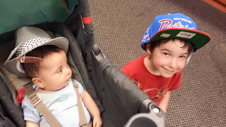 Wyatt and Owen try out some hats
