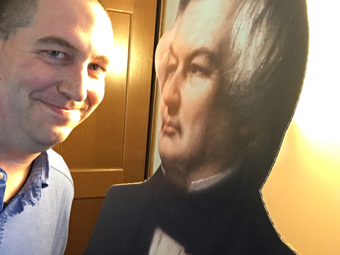 Brady with a cardboard cutout of Millard Fillmore