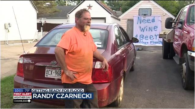 "Randy Czarnecki: Getting Ready For Flood. His list reads: ""Need Wine + Beer"""