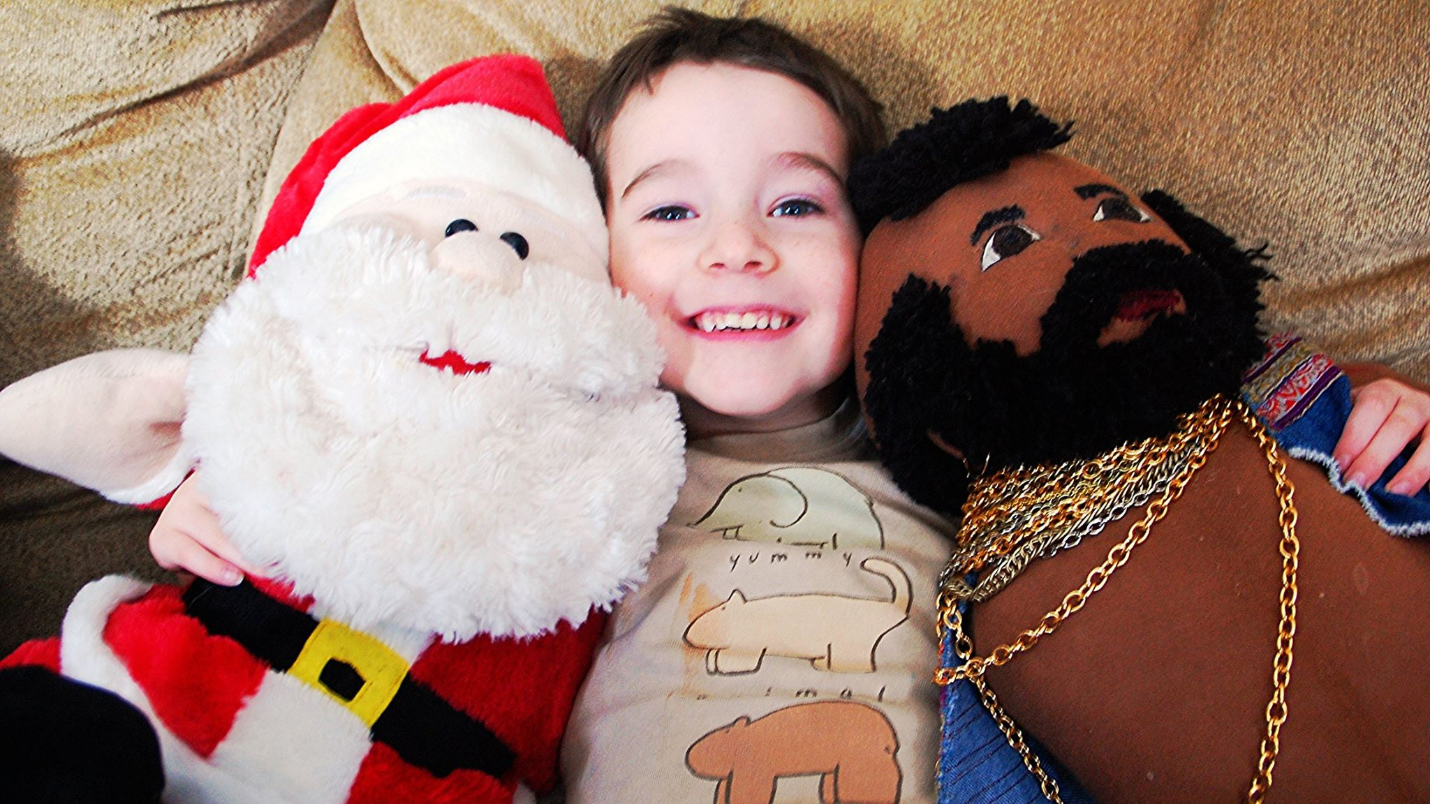 Three year old with Santa and Mr. T