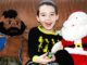 Four year old with Mr. T and Santa