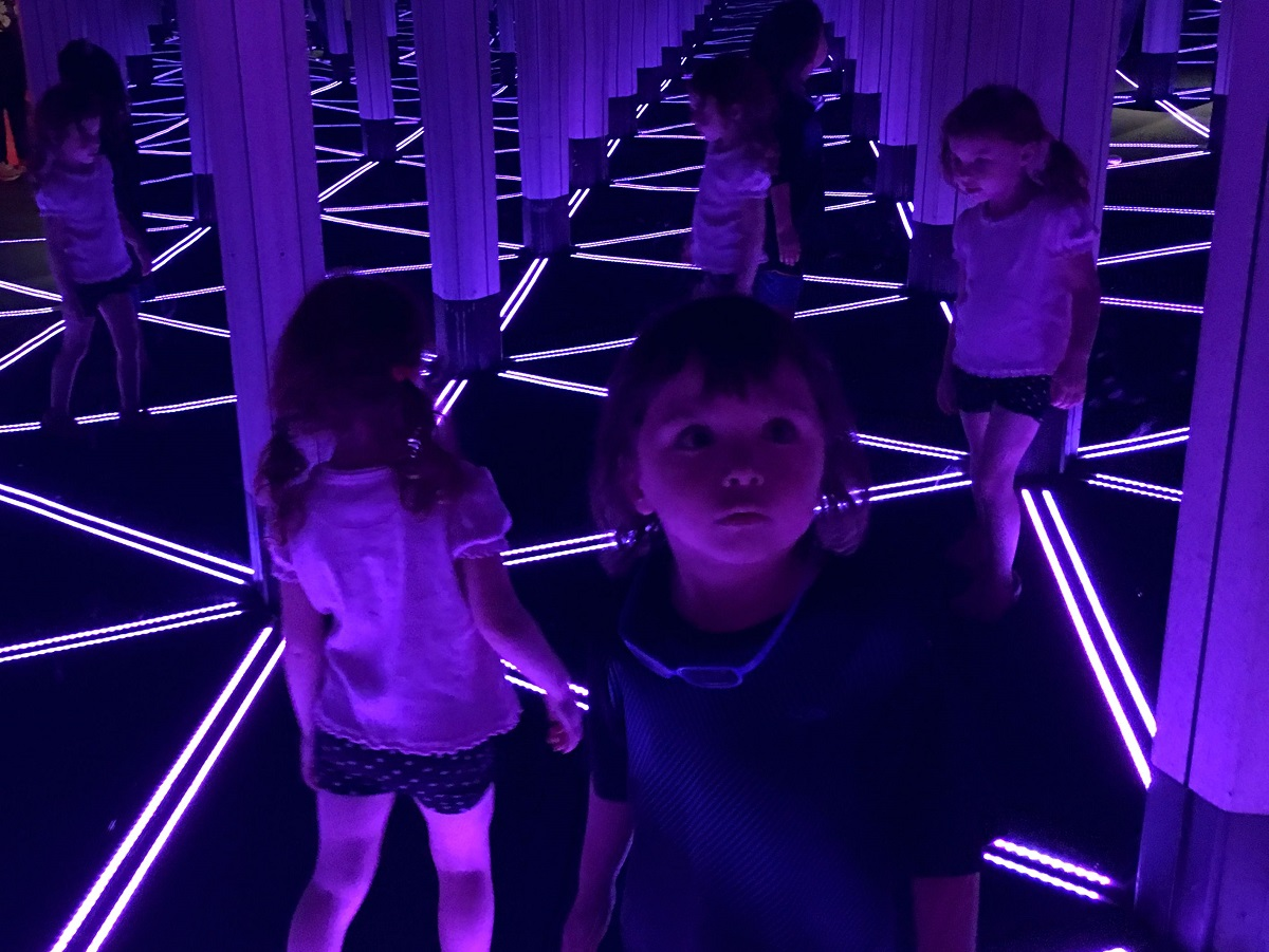 Two Carlson kids in the mirror maze