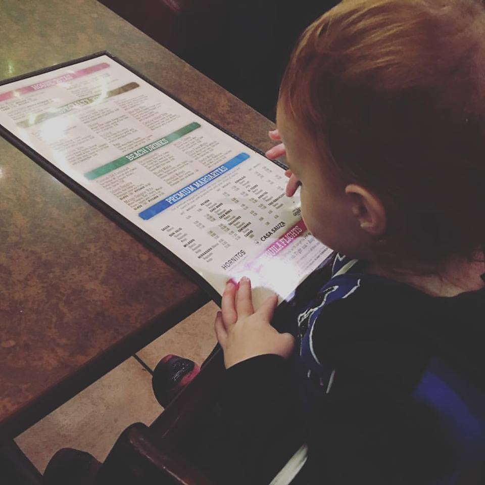 One year old checking out the margarita menu (!)