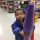 Two year old with giant crayons