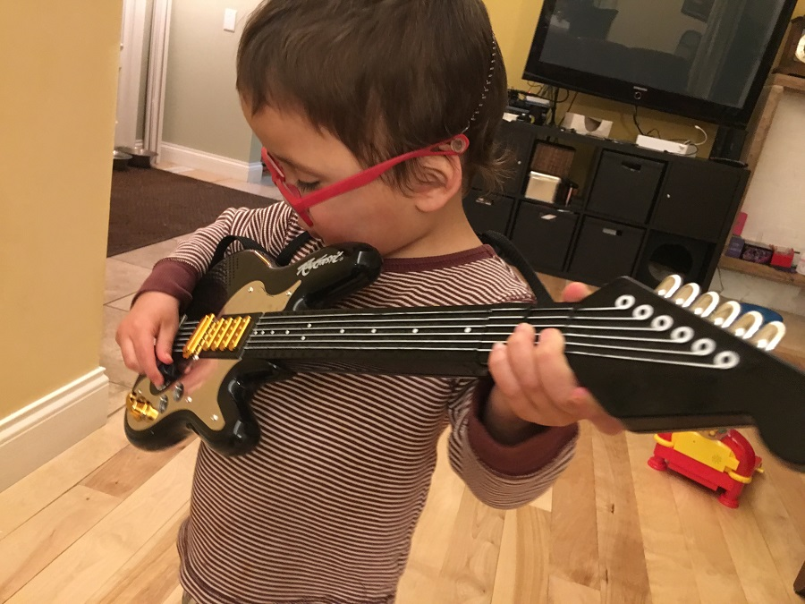 Two year old rocks out with a guitar
