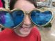 Eight year old in giant heart glasses