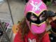 Three year old in a pink Power Ranger mask