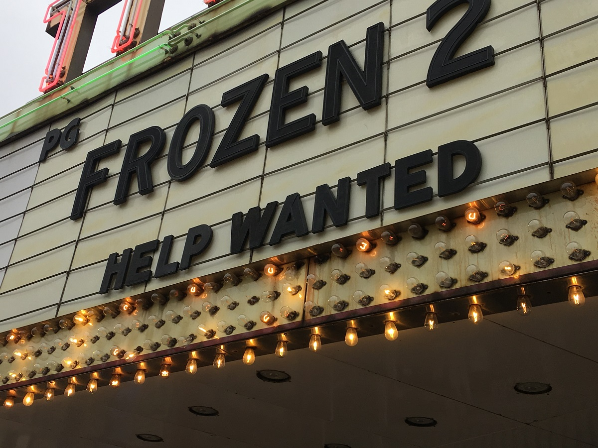 """Movie marquee reads: """"FROZEN 2 HELP WANTED"""""""