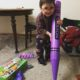 Three year old with his giant purple crayon