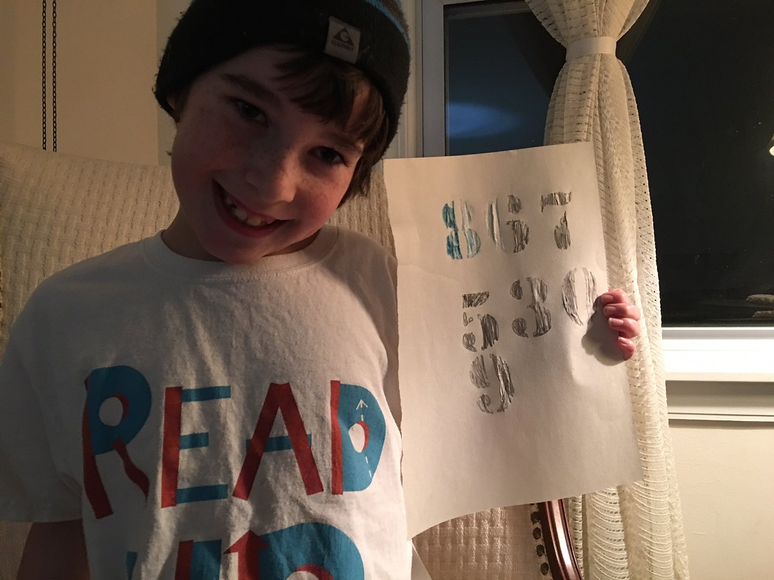 """Seven year old stenciled """"867-5309"""" onto a paper"""