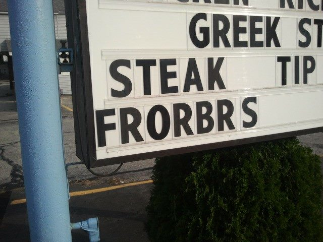 Restaurant sign advertises STEAK FRORBRS