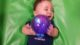 Baby boy is excited about the glowing toy ball