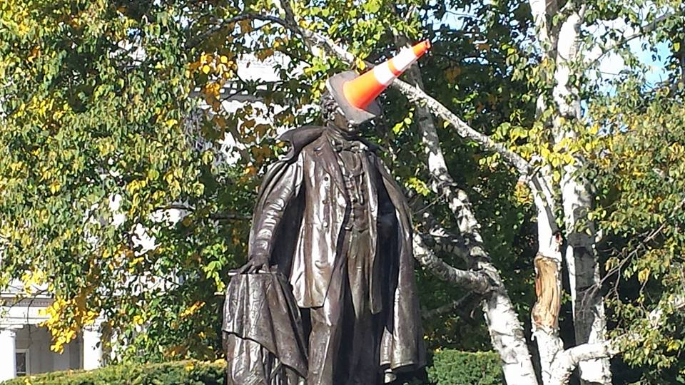 A traffic cone on the Franklin Pierce statue