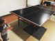 Two year old and one year old play table tennis